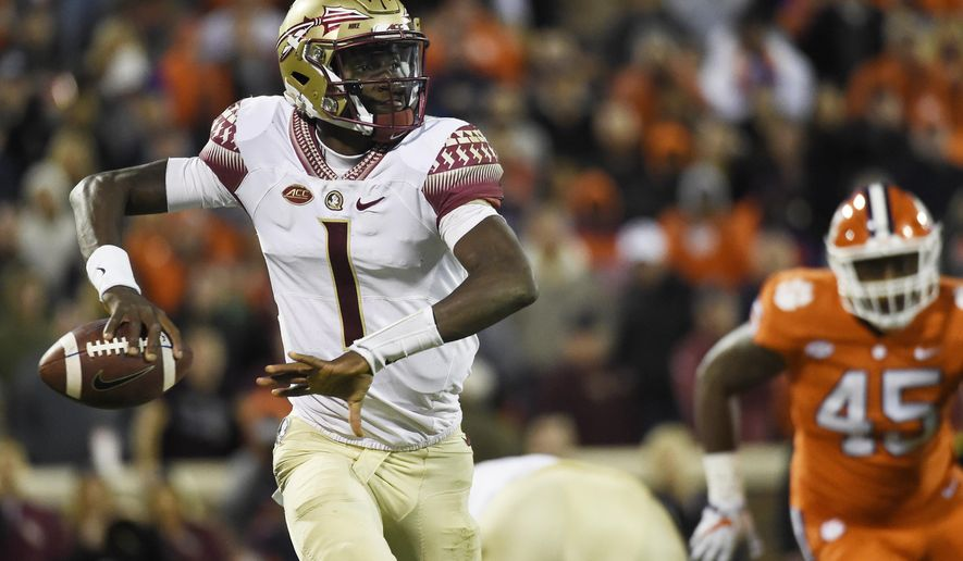 Florida State quarterback James Blackman (1) looks to pass against Clemson during the second half of an NCAA college football game, Saturday, Nov. 11, 2017, in Clemson, S.C. (AP Photo/Rainier Ehrhardt)