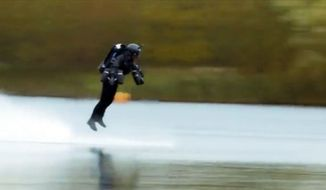 The fastest speed achieved in a body-controlled jet engine power suit by Richard Browning. (Courtesy Reuters)