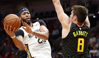 New Orleans Pelicans forward Anthony Davis (23) looks to shoot against Atlanta Hawks forward Luke Babbitt forward (8) during the first half of an NBA basketball game in New Orleans, Monday, Nov. 13, 2017. (AP Photo/Tyler Kaufman)