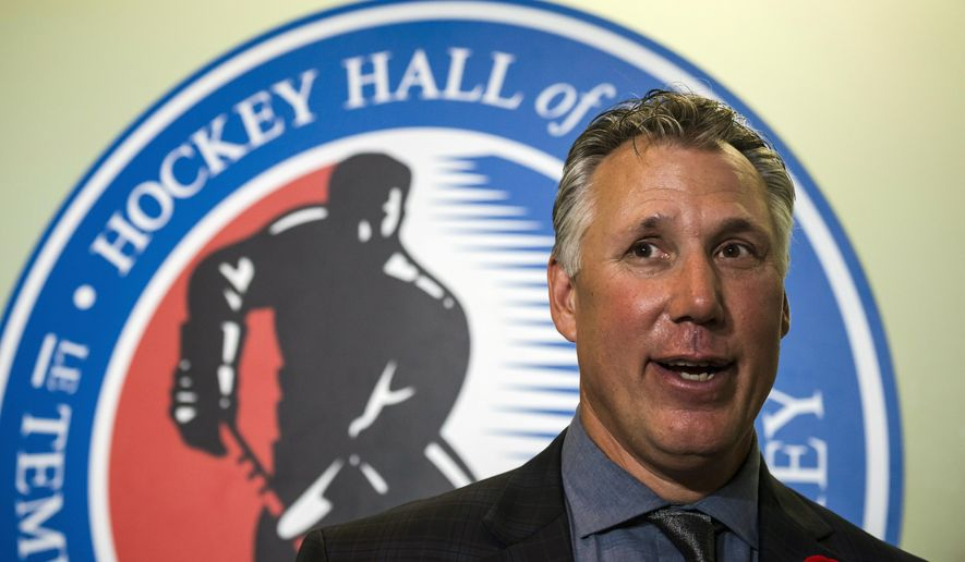 Hockey Hall of Fame inductee Dave Andreychuk speaks to reporters after a news conference in Toronto, Friday, Nov. 10, 2017. (Christopher Katsarov/The Canadian Press via AP)