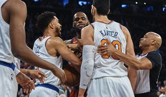 Cleveland Cavaliers' LeBron James, center, discusses with New York Knicks' Enes Kanter, center right, and Courtney Lee, center left, during the first half of a NBA basketball game at Madison Square Garden in New York, Monday, Nov. 13, 2017. (AP Photo/Andres Kudacki)