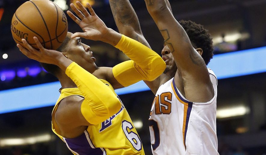 Los Angeles Lakers guard Jordan Clarkson (6) drives to the hoop against Phoenix Suns forward Marquese Chriss (0) during the first half of an NBA basketball game Monday, Nov. 13, 2017, in Phoenix. (AP Photo/Ross D. Franklin)