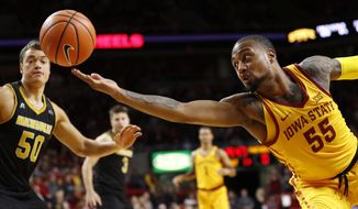 Iowa State forward Jeff Beverly (55) fights for a loose ball with Milwaukee forward Brett Prahl (50) during the first half of an NCAA college basketball game, Monday, Nov. 13, 2017, in Ames, Iowa. (AP Photo/Charlie Neibergall)