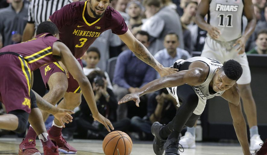 Minnesota's Dupree McBrayer, left, and Jordan Murphy (3) vie with Providence's Rodney Bullock, right, for the ball in the first half of an NCAA college basketball game Monday, Nov. 13, 2017, in Providence, R.I. (AP Photo/Steven Senne)