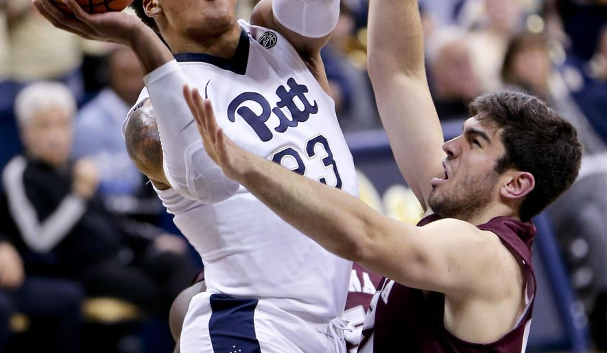 Pittsburgh's Shamiel Stevenson, left, shoots over Montana's Fabijan Krslovic in the first half of an NCAA college basketball game, Monday, Nov. 13, 2017, in Pittsburgh. (AP Photo/Keith Srakocic)