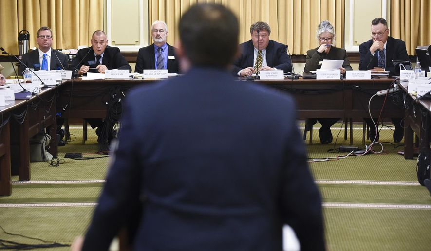 Dan Villa, budget director for Gov. Steve Bullock, testifies before the joint hearing of the House Appropriations and Senate Finance and Claims committees during the first day of the special legislative session Monday, Nov. 13, 2017, during the first day of the special legislative session in Helena.  (Thom Bridge/Independent Record via AP)