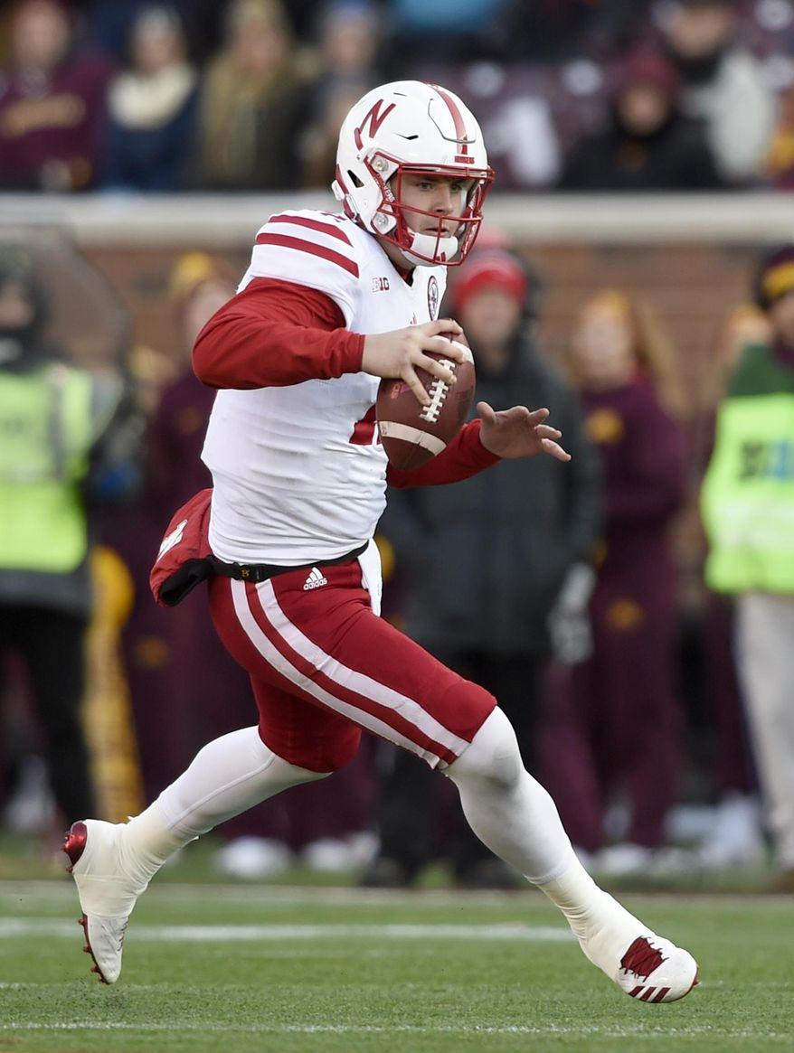 Nebraska quarterback Patrick O'Brien (12) scrambles against Minnesota during the fourth quarter of an NCAA college football game on Saturday, Nov. 11, 2017, in Minneapolis. Minnesota won 54-21. (AP Photo/Hannah Foslien)