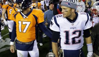 New England Patriots quarterback Tom Brady (12) and Denver Broncos quarterback Brock Osweiler (17) meet after an NFL football game, Sunday, Nov. 12, 2017, in Denver. The Patriots won 41-16. (AP Photo/Jack Dempsey)