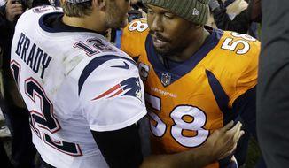 New England Patriots quarterback Tom Brady (12) greets Denver Broncos outside linebacker Von Miller (58) after an NFL football game, Sunday, Nov. 12, 2017, in Denver. The Patriots won 41-16. (AP Photo/Jack Dempsey)