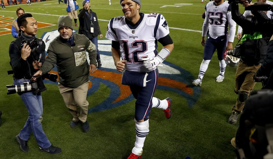 New England Patriots quarterback Tom Brady (12) cheers Patriots fans as he leaves the field after an NFL football game against the Denver Broncos, Sunday, Nov. 12, 2017, in Denver. The Patriots won 41-16. (AP Photo/David Zalubowski)