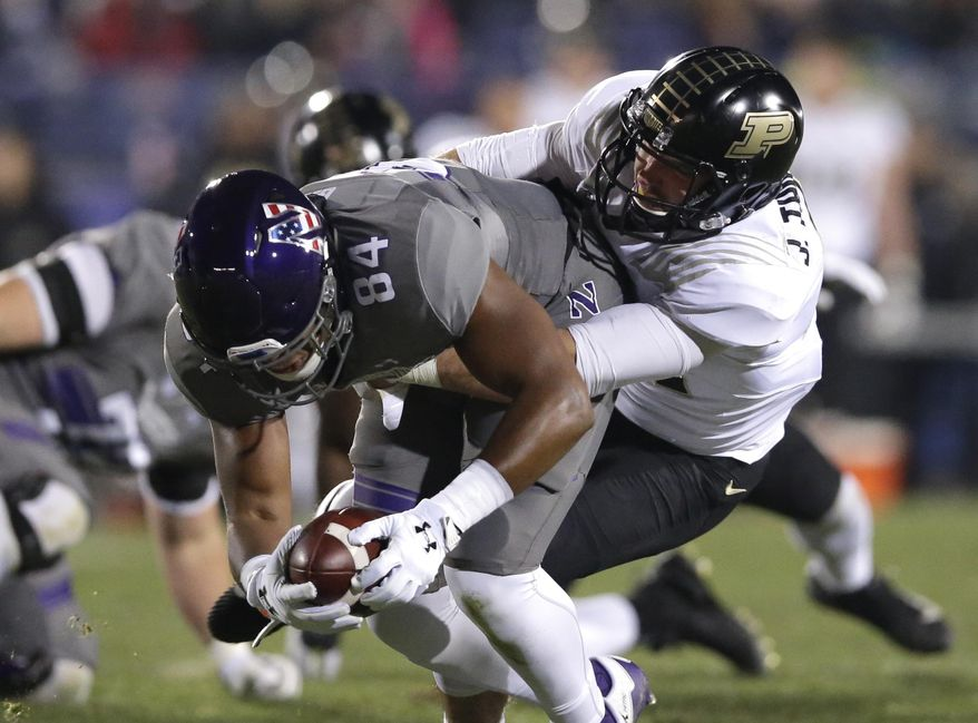 Purdue safety Jacob Thieneman, right, tackles Northwestern slot back Cameron Green during the first half of an NCAA college football game Saturday, Nov. 11, 2017, in Evanston, Ill. (AP Photo/Nam Y. Huh)