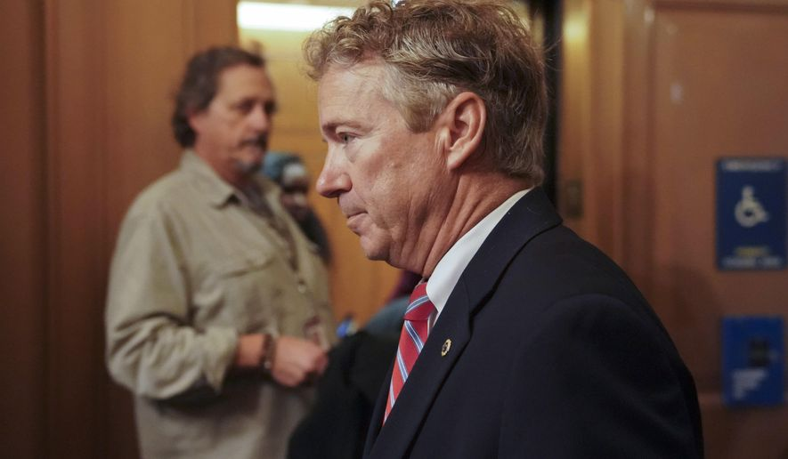 Sen. Rand Paul, R-Ky., arrives on Capitol Hill in Washington Monday, Nov. 13, 2017. Paul entered the chamber, hands by his sides, to cast a vote. Paul was attacked Nov. 3 while mowing his lawn, authorities said.  (AP Photo/Pablo Martinez Monsivais)