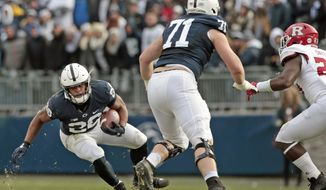 Penn State's Saquon Barkley (26) finds a hole in the Rutgers defense during the second half of an NCAA college football game in State College, Pa., Saturday, Nov. 11, 2017. Penn State 35-6. (AP Photo/Chris Knight)