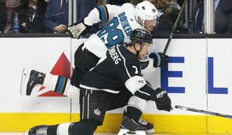 Los Angeles Kings defenseman Oscar Fantenberg, bottom, checks San Jose Sharks left wing Mikkel Boedker into the boards during the first period of an NHL hockey game, Sunday, Nov. 12, 2017, in Los Angeles. (AP Photo/Danny Moloshok)