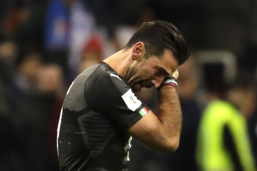 Italy goalkeeper Gianluigi Buffon cries after his team got eliminated in the World Cup qualifying play-off second leg soccer match between Italy and Sweden, at the Milan San Siro stadium, Italy, Monday, Nov. 13, 2017. (AP Photo/Luca Bruno)