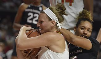 Maryland's Kristen Confroy, left, struggles for a rebound against South Carolina's Alexis Jennings in the first half of an NCAA basketball game, Monday, Nov. 13, 2017, in College Park, Md. (AP Photo/Gail Burton) **FILE**