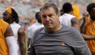 FILE -- In this Nov. 4, 2017, file photo, Tennessee associate head coach and defensive line coach Brady Hoke makes his way back to the locker room before an NCAA football game between Tennessee and Southern Mississippi in Knoxville, Tenn. The firing of Tennessee head coach Butch Jones means that Hoke returns to the head coaching ranks, at least for a couple more weeks. The former Michigan, San Diego State and Ball State coach was named Tennessee's interim head coach for the Volunteers' final two regular-season games. (C.B. Schmelter/Chattanooga Times Free Press via AP, File)