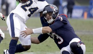 Los Angeles Rams cornerback Blake Countess, left, is tackled by Houston Texans quarterback Tom Savage after making an interception during the second half of an NFL football game, Sunday, Nov. 12, 2017, in Los Angeles. (AP Photo/Jae C. Hong)