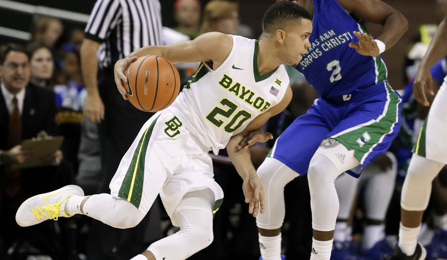 Baylor guard Manu Lecomte (20) of Belgium advances the ball as Texas A & M Corpus Christi's Myles Smith (2) defends in the first half of an NCAA college basketball game, Monday, Nov. 13, 2017, in Waco, Texas. (AP Photo/Tony Gutierrez)