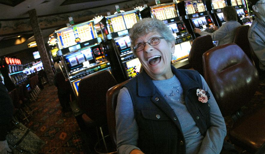 In this Nov. 1, 2017, photo, Lil Spravzoff, of Bismarck, takes a break from playing a slot machine at Prairie Knights Casino and Lodge south of Mandan, N.D., to talk about how she and her late husband would drive to the casino for concerts. Finances at the casino run by the Standing Rock Sioux Tribe are slowly improving, after facing a $6 million shortfall during the peak of the Dakota Access crude oil pipeline protest in February. (Mike McCleary/The Bismarck Tribune via AP)