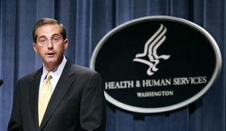 In this June 8, 2006, file photo, then Deputy Health and Human Services Secretary Alex Azar meets reporters at the HHS Department in Washington. Azar was a top HHS official during the George W. Bush administration. (AP Photo/Evan Vucci) ** FILE **