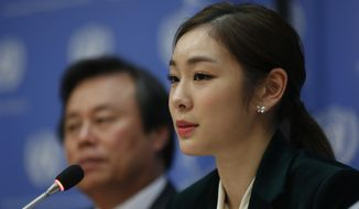 South Korea's 2010 Olympic gold medalist figure skater Yuna Kim, right, speaks during a press conference, Monday Nov. 13, 2017 at U.N. headquarters. The U.N. General Assembly adopted a South Korea sponsored resolution that 2018 Pyeong Chang Winter Olympics build a peaceful and better world through sport and Olympic ideal. (AP Photo/Bebeto Matthews)