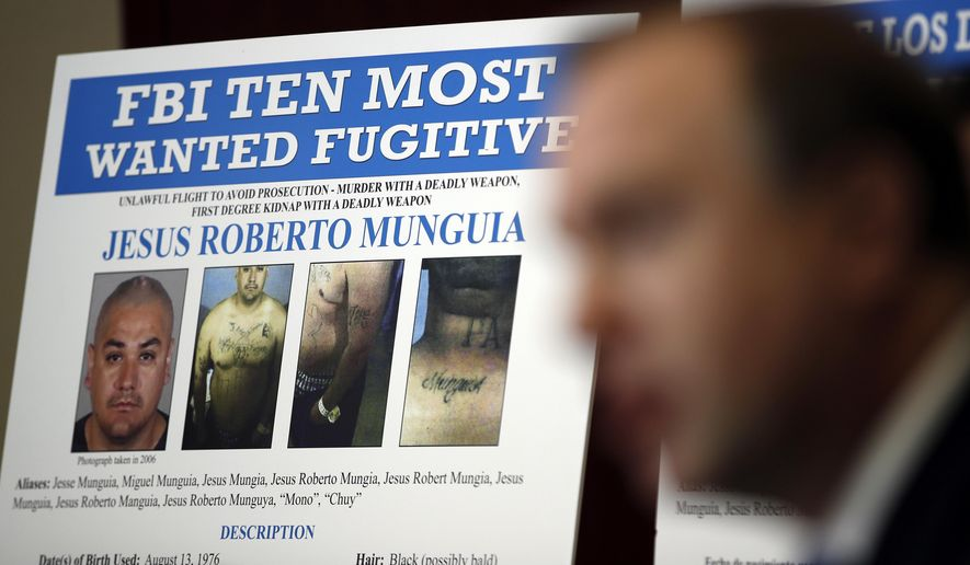 Aaron Rouse, FBI special agent in charge of the Las Vegas field office, speaks during a news conference to announce the addition of fugitive Jesus Roberto Munguia to the FBI's Top 10 most wanted list Monday, Nov. 13, 2017, in Las Vegas. Munguia is wanted for the alleged murder of Sherryl Sacueza in Las Vegas in 2008. (AP Photo/John Locher)