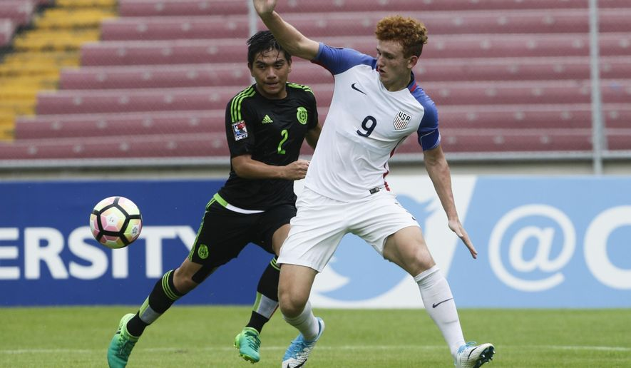 """FILE - In this May 7, 2017, file photo, United States' Josh Sargent, right, and Mexico's Adrian Vazquez fight for the ball during the CONCACAF under-17 soccer championship final in Panama City, Panama. Josh Sargent remembered when coach John Hackworth greeted the U.S. Under-17 team at breakfast in India last month and told players the American senior team had failed to qualify for next year's World Cup. """"Everybody thought he was joking,"""" Sargent said. In the wake of the failure, Sargent has been promoted to the national team along with Weston McKennie and Tyler Adams for Tuesday's exhibition at Portugal. (AP Photo/Arnulfo Franco, File)"""