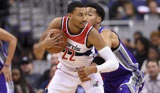 Washington Wizards forward Otto Porter Jr. (22) handles the ball during the first half of an NBA basketball game against the Sacramento Kings, Monday, Nov. 13, 2017, in Washington. (AP Photo/Nick Wass)