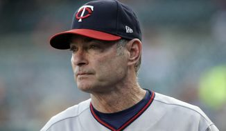 FILE - In this Sept. 23, 2017, file photo, Minnesota Twins manager Paul Molitor watches from the dugout during the first inning of the team's baseball game against the Minnesota Twins in Detroit. Molitor has won the American League Manager of the Year award after the Twins became the first team to make the playoffs following a 100-loss season. (AP Photo/Carlos Osorio, File) **FILE**