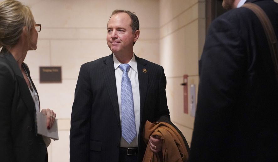 Rep. Adam Schiff, D-Calif., speaks with a journalist as he waits for an elevator after leaving a closed House Intelligence Committee hearing on Capitol Hill in Washington, Tuesday, Nov. 14, 2017. (AP Photo/Pablo Martinez Monsivais)