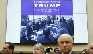 """An image reading """"National Security Meeting TRUMP Make America Great Again Washington, D.C, March 31 2016"""" is displayed behind Attorney General Jeff Sessions as he testifies during a House Judiciary Committee hearing on Capitol Hill, Tuesday, Nov. 14, 2017 in Washington. (AP Photo/Carolyn Kaster)"""
