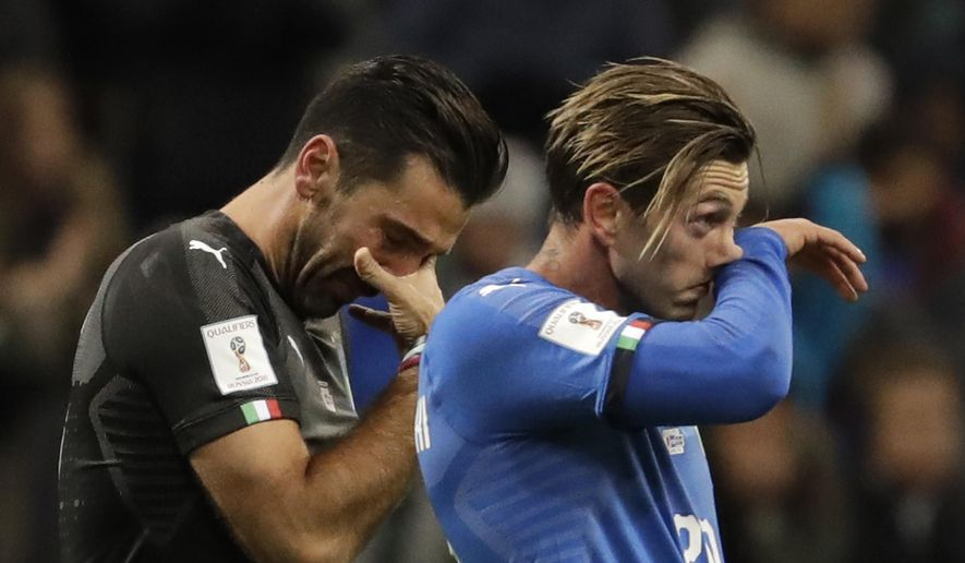 Italy's goalkeeper Gianluigi Buffon, left, and Manolo Gabbiadini react to their team's elimination in the World Cup qualifying play-off second leg soccer match between Italy and Sweden, at the Milan San Siro stadium, Italy, Monday, Nov. 13, 2017. (AP Photo/Luca Bruno)