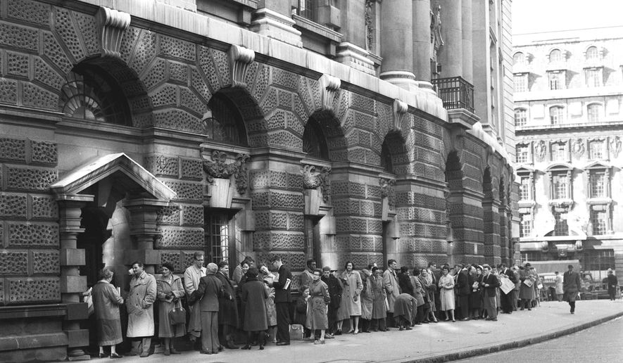"FILE - In this B/W file photo dated Oct. 27, 1960,  a queue forms outside The Old Bailey Central Criminal Court, in London, for admission to the public gallery where the ""Lady Chatterley's Lover"" case is resuming.  The towering legal figure who helped liberalize British laws around sex and freedom of expression, successfully defending Penguin Books against obscenity charges for publishing D.H. Lawrence's novel ""Lady Chatterley's Lover"", the lawyer Jeremy Hutchinson died Monday Nov. 13, 2017, aged 102. (AP Photo, FILE)"