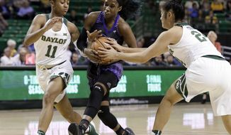 Baylor's Alexis Morris (11) and Natalie Chou, right, attempt to stop Central Arkansas' Kamry Orr (2) on a drive to the basket during the first half of an NCAA college basketball game, Tuesday, Nov. 14, 2017, in Waco, Texas. (AP Photo/Tony Gutierrez)