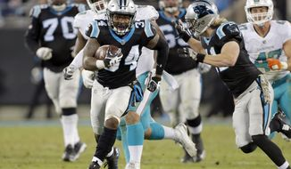 Carolina Panthers' Cameron Artis-Payne (34) runs for a long gain against the Miami Dolphins in the second half of an NFL football game in Charlotte, N.C., Monday, Nov. 13, 2017. (AP Photo/Bob Leverone)