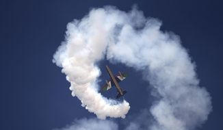 A plane of Al Fursan, or the Knights, a UAE Air Force aerobatic display team, performs during the Dubai Air Show, United Arab Emirates, Monday, Nov. 13, 2017. (AP Photo/Kamran Jebreili)