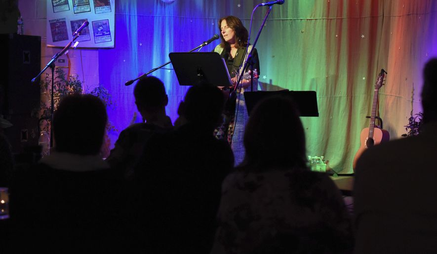 In this Nov. 4, 2017 photo, Liz Collins, of Upper Moreland, performs at Karen's Place, an underground Christian cafe in Doylestown Township, Pa. (Michele Haddon /The Intelligencer via AP)