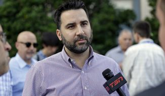 New Atlanta Braves general manager Alex Anthopoulos talks with members of the media at the annual MLB baseball general managers' meetings, Tuesday, Nov. 14, 2017, in Orlando, Fla. (AP Photo/John Raoux)