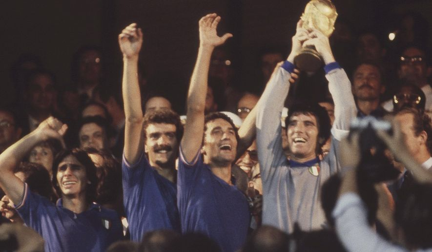 FILE - The July 11, 1982 file photo shows Italian captain and goalkeeper Dino Zoff, right, holding the World Cup trophy aloft,after the presentation ceremony, at the Santiago Bernabeu Stadium, Madrid. The best coaches in Italy emigrate. The stadiums around the country are falling apart. The lingering problems affecting Italy's domestic league might just be the reason for the country's failure to qualify for next year's World Cup. (AP Photo)