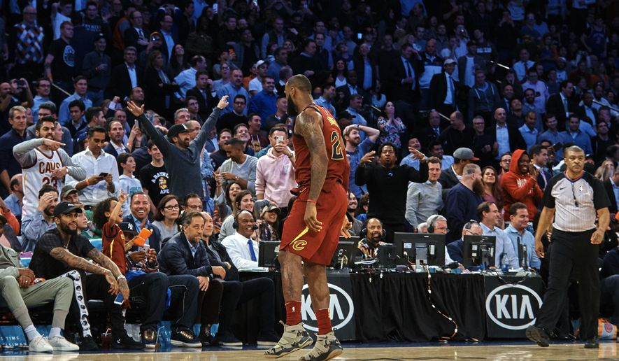 Cleveland Cavaliers' LeBron James, celebrates looking at the spectators after scoring three points during the second half of a NBA basketball game against New York Knicks at Madison Square Garden in New York, Monday, Nov. 13, 2017. (AP Photo/Andres Kudacki)