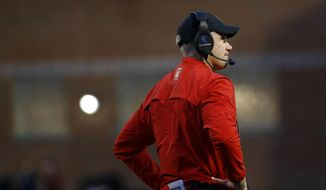 In this Saturday, Nov. 11, 2017, photo, Maryland head coach DJ Durkin stands on the field during the first half of an NCAA college football game against Michigan in College Park, Md. (Associated Press) **FILE**