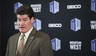 FILE - In this July 22, 2014, file photo, Mountain West Commissioner Craig Thompson speaks during the Mountain West Conference football media day at the Cosmopolitan hotel-casino in Las Vegas. At Wyoming, the trade-off the Mountain West is making for television is apparent. The Cowboys drew more fans to Memorial Stadium for afternoon games in September against Gardner-Webb and Texas State than they did for the Mountain West opener against Hawaii, which kicked off at 8:15 p.m. Mountain time. Mountain West Commissioner Craig Thompson said the conference is crunching numbers to get a better handle how scheduling for TV affects other revenue sources.  (Chase Stevens/Las Vegas Review-Journal via AP)
