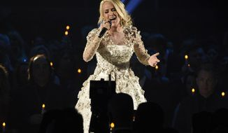 "FILE - In this Wednesday, Nov. 8, 2017, file photo, Carrie Underwood performs ""Softly and Tenderly"" during an In Memoriam tribute at the 51st annual CMA Awards at the Bridgestone Arena in Nashville, Tenn. In a statement Sunday, Nov. 12, on Twitter, Underwood thanked her fans for messages of support following a fall on steps outside her home on Friday. (Photo by Chris Pizzello/Invision/AP, File)"