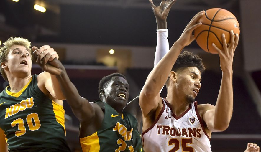 North Dakota State forward Spencer Eliason (30), forward Deng Geu (23) and Southern California forward Bennie Boatwright (25) vie for a rebound during the first half of an NCAA college basketball game, Monday, Nov. 13, 2017, in Los Angeles. (AP Photo/Gus Ruelas)