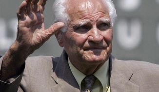 "In this Aug. 2, 2007, file photo, Boston Red Sox Hall of Famer Bobby Doerr waves to the crowd at Fenway Park in Boston, prior to a baseball game between the Red Sox and the Baltimore Orioles. Doerr, a Hall of Fame second baseman who was dubbed the ""silent captain"" by longtime Red Sox teammate and life-long friend Ted Williams, has died. He was 99. (AP Photo/Elise Amendola, File)"