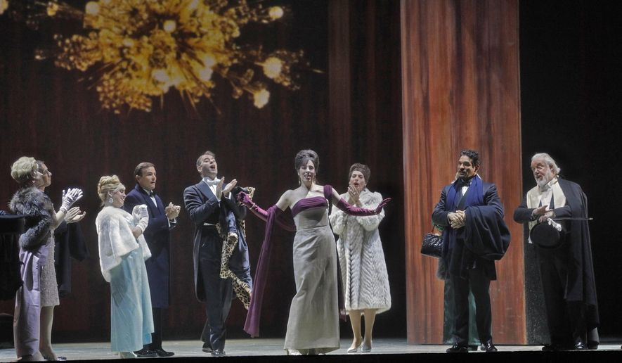 """This image released by the Metropolitan Opera shows a performance of """"The Exterminating Angel,"""" will be shown in selected theaters on Saturday. (Ken Howard/Metropolitan Opera via AP)"""