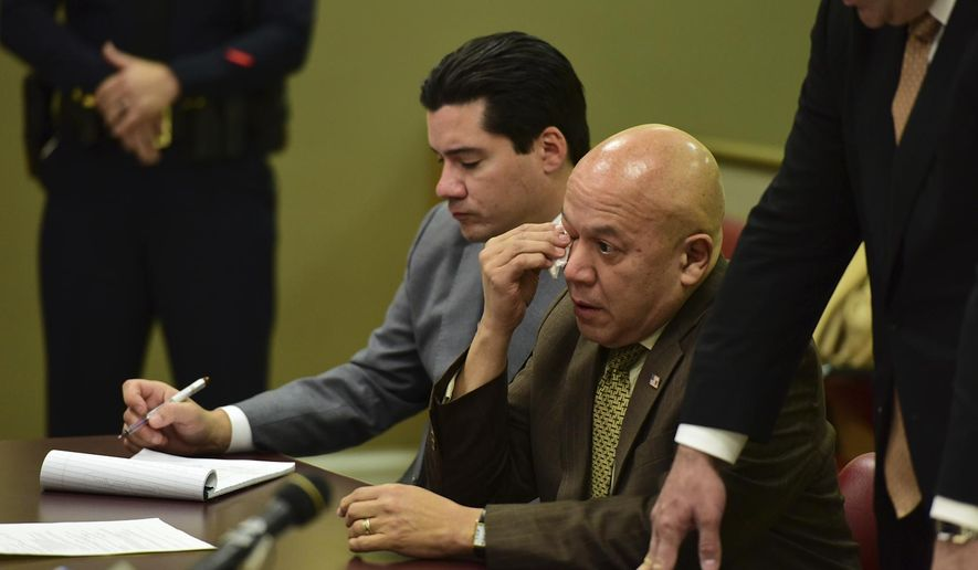 """Former Paterson Mayor Jose """"Joey"""" Torres wipes tears from his eyes during his sentencing hearing on Tuesday, Nov. 14, 2017, in Jersey City, N.J. He was sentenced to five years of prison time for directing city employees to do work at a warehouse leased by his daughter and nephew. (Tariq Zehawi/The Record via AP, Pool)"""