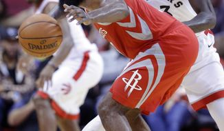 Houston Rockets guard James Harden (13) briefly loses the ball under pressure from Toronto Raptors forward Pascal Siakam (43) during the first half of an NBA basketball game, Tuesday, Nov. 14, 2017, in Houston. (AP Photo/Michael Wyke)