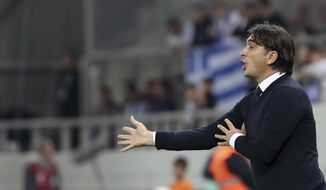 Croatia coach Zlatko Dalic gives directions to his players during the World Cup qualifying play-off second leg soccer match between Greece and Croatia at Georgios Karaiskakis stadium, in Piraeus port, near Athens, Sunday Nov. 12, 2017. (AP Photo/Yorgos Karahalis)